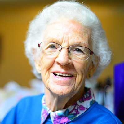 Photo of an older woman smiling